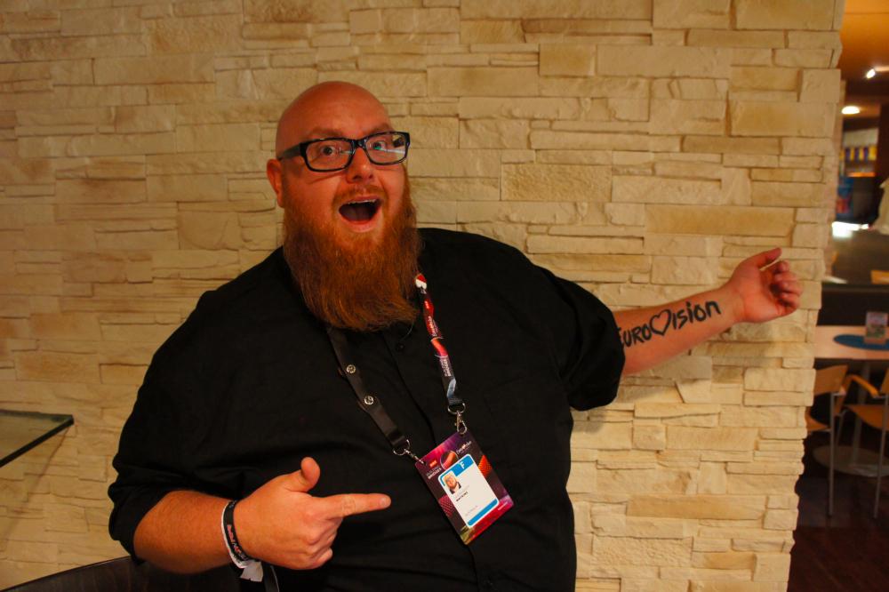 Jason Watkins showing off his Eurovision tattoo